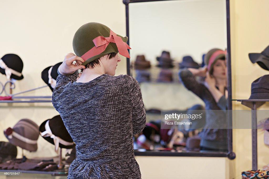 Customer tries on hat : Stock Photo