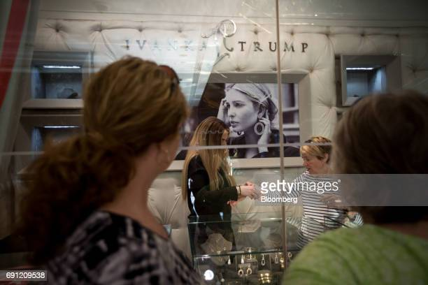 A customer tries on jewelry at the Ivanka Trump Collection store at Trump Tower in New York US on Thursday June 1 2017 Two Chinese labor activists...
