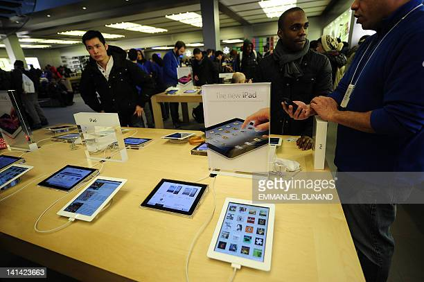 A customer tries the a new Apple iPad at Apple's flagship store on Fifth Avenue in New York on March 16 2012 The latest iPad went on sale of Friday...