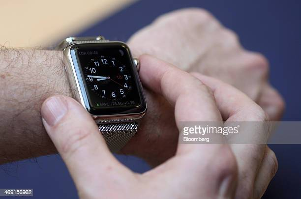 A customer tries the different functions of a new Apple Watch smartwatch during a preview event at Apple Inc's Covent Garden store in London UK on...