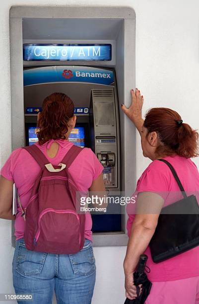 Customer use a Citigroup Inc Banamex ATM machine in Mexico City Mexico on Monday March 28 2011 The pension fund at Citigroup Inc's Banamex unit is...