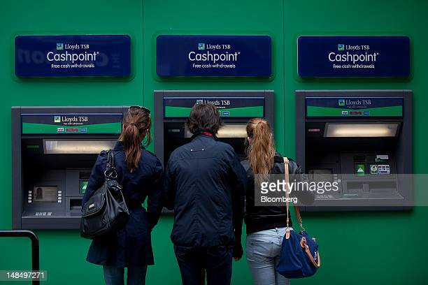 A customer uses a automated teller machine outside a Lloyds TSB bank branch part of the Lloyds Banking Group Plc in London UK on Wednesday July 18...