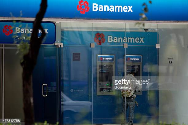 A customer uses a Banamex automated teller machine at a branch in Mexico City Mexico on Wednesday Oct 15 2014 Citigroup Inc's Mexico unit Banamex was...