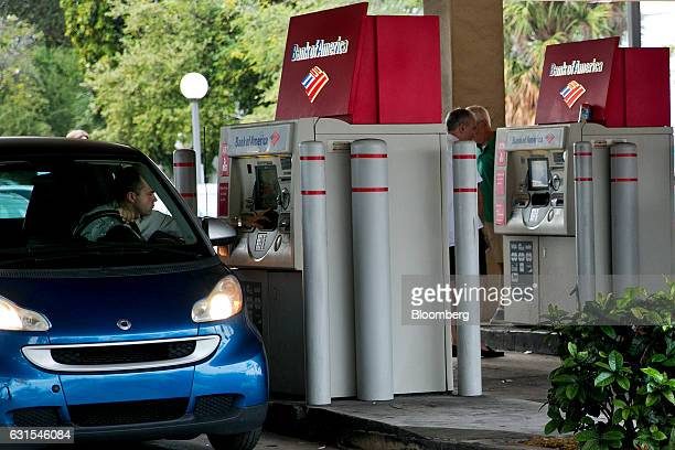 A customer uses a drivethrough automatic teller machine outside a Bank of America Corp branch in Miami Beach Florida US on Wednesday Jan 4 2017 Bank...