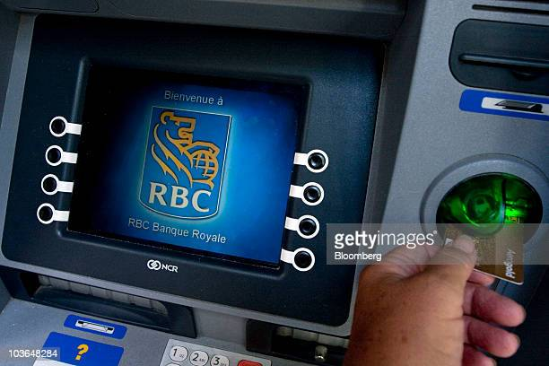 A customer uses a Royal Bank of Canada automated teller machine in downtown Toronto Ontario Canada on Thursday Aug 26 2010 Royal Bank of Canada...