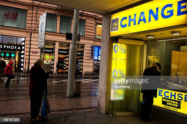 A customer uses a Western Union currency exchange to change money in Prague Czech Republic on Tuesday Jan 8 2013 The Czech economy is showing weak...