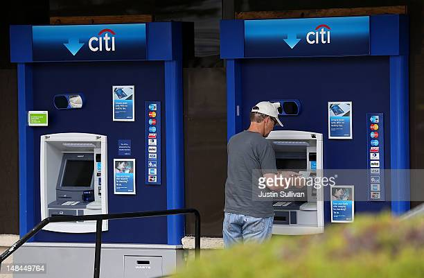 A customer uses an ATM at a Citibank branch office on July 16 2012 in San Rafael California Citigroup announced a decline in quarterly earnings of 12...