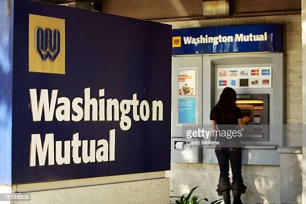 A customer uses an ATM machine at a Washington Mutual bank December 11 2007 in La Canada California The nation's biggest savings and loan Washington...