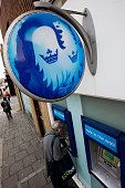 A customer uses an ATM machine outside a branch of Barclays bank in London UK on Monday Nov 9 2009 Governments spent more than $500 billion in the...