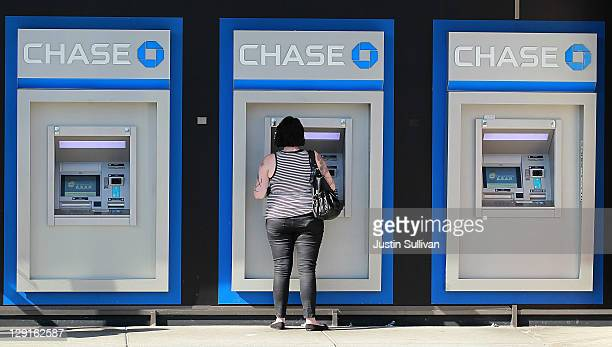 A customer uses an ATM outside of a Chase bank office on October 13 2011 in Oakland California JPMorgan Chase Co a nearly 33 percent decline in third...