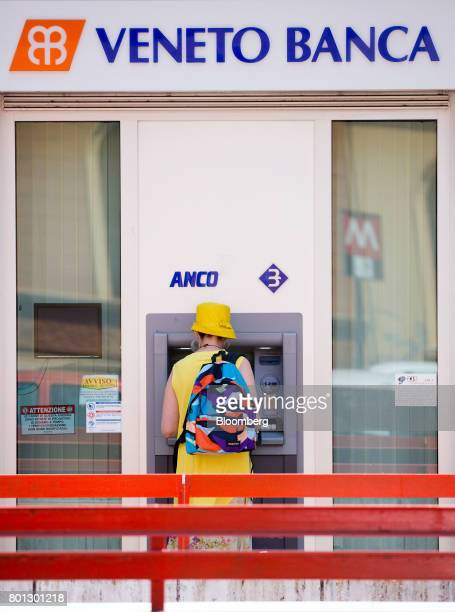 A customer uses an automated teller machine at a Veneto Banca SpA bank branch in Rome Italy on Monday June 26 2017 Italy orchestrated its biggest...