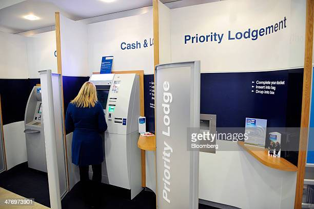 A customer uses an automated teller machine inside a Bank of Ireland Plc bank branch in Dublin Ireland on Thursday Feb 27 2014 Bank of Ireland Plc...