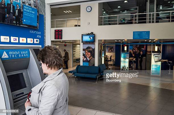A customer uses an automated teller machine inside a TBC Bank JSC bank branch in Tbilisi Georgia on Tuesday April 15 2014 Georgia home to energy...