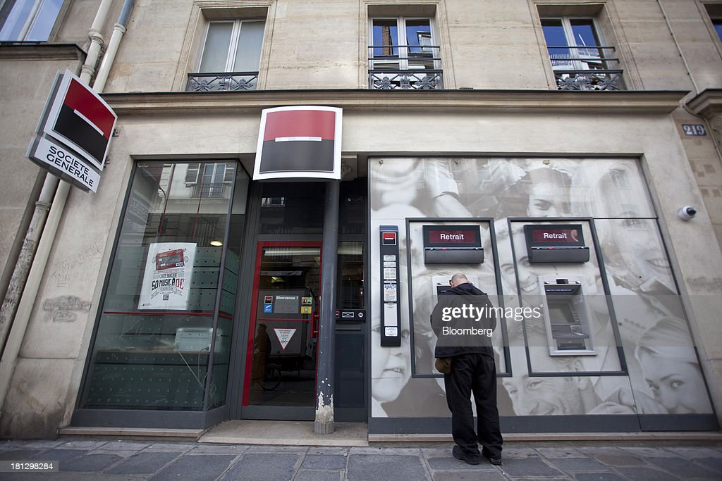A customer uses an automated teller machine (ATM) operated by Societe Generale SA bank branch in Paris, France, on Thursday, Sept. 19, 2013. Bank of France General Council member Bernard Maris said France will end up restructuring its debt as tax 'optimization' by large companies including Google Inc. will leave too big a burden on the middle class. Photographer: Balint Porneczi/Bloomberg via Getty Images