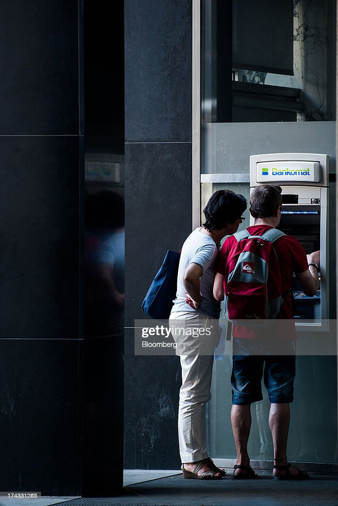 A customer uses an automated teller machine (ATM) operated by UniCredit Bank Austria AG, also known as Bank Austria, in Vienna, Austria, on Tuesday, July 23, 2013. Kommunalkredit Austria AG, the Austrian nationalized municipal lender, will have to wind down its loan book and close when that's complete after attempts to sell the bank failed, the European Commission said. Photographer: Akos Stiller/Bloomberg via Getty Images