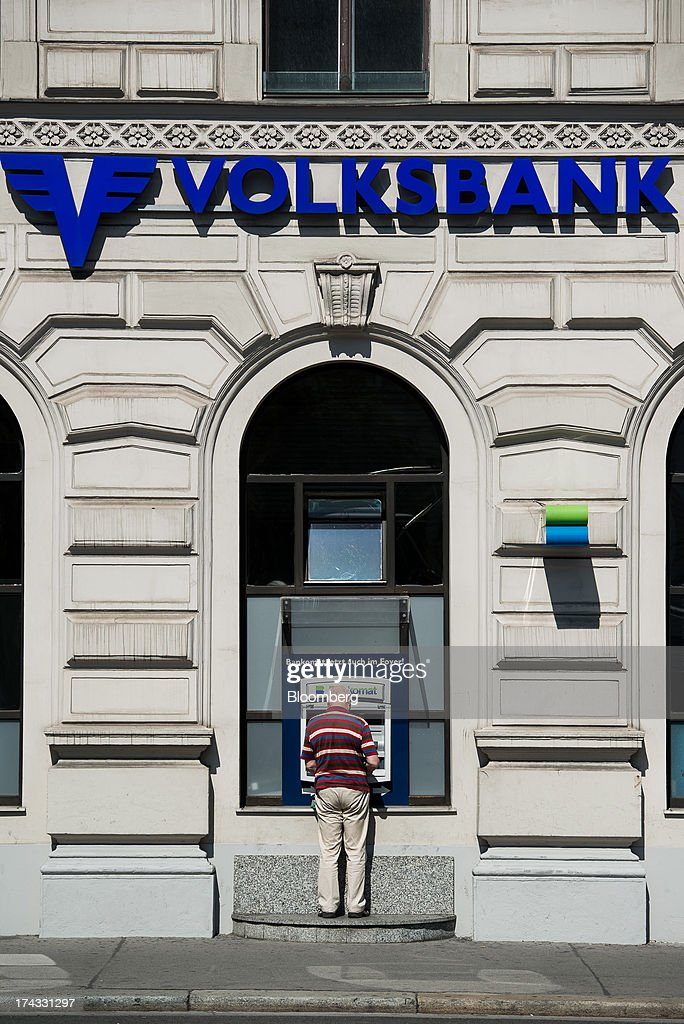 A customer uses an automated teller machine (ATM) operated by Volksbank International AG, also known as Oesterreichische Volksbanken AG, in Vienna, Austria, on Tuesday, July 23, 2013. Kommunalkredit Austria AG, the Austrian nationalized municipal lender, will have to wind down its loan book and close when that's complete after attempts to sell the bank failed, the European Commission said. Photographer: Akos Stiller/Bloomberg via Getty Images