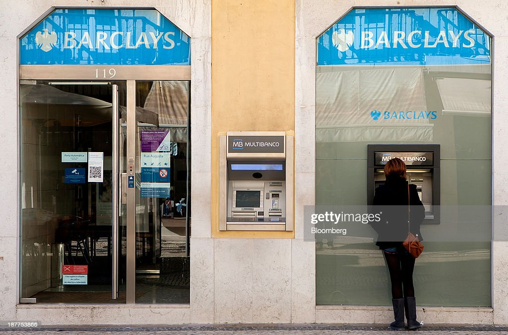 A customer uses an automated teller machine (ATM) outside a Barclays Bank Plc bank branch in Lisbon, Portugal, on Tuesday, Nov. 12, 2013. Portugal's jobless rate dropped for a second quarter, falling to 15.6 percent in the three months through September as the country's economy shows signs of recovery. Mario Proenca/Bloomberg via Getty Images