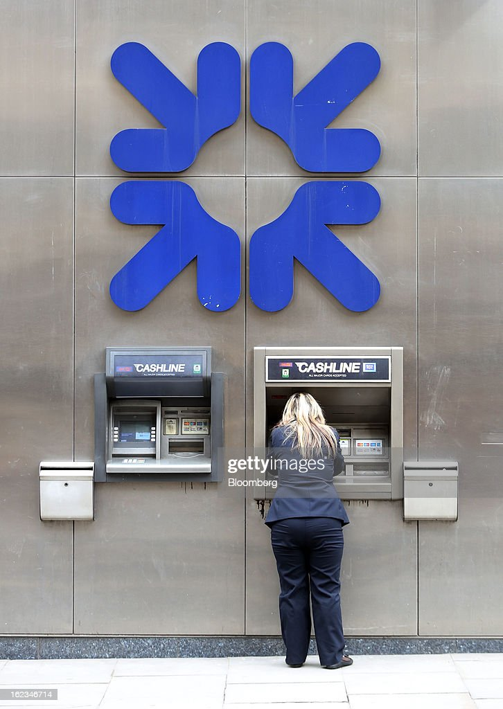 A customer uses an automated teller machine (ATM) outside a branch of a Royal Bank of Scotland Group Plc (RBS) bank, in London, U.K., on Friday, Feb. 22, 2013. RBS, Britain's biggest publicly owned lender, was fined $612 million by regulators in the U.K. and the U.S. for rigging the London interbank offered rate and similar benchmarks. Photographer: Chris Ratcliffe/Bloomberg via Getty Images