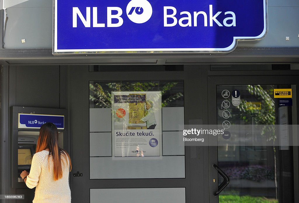 A customer uses an automated teller machine (ATM) outside a branch of Nova Ljubljanska Banka d.d. (NLB) in Belgrade, Serbia, on Sunday, Oct. 20, 2013. Serbia's government revealed a salvo of measures to bring the public finance deficit and debt back under control by 2017 after the head of the largest coalition party warned the country was on the brink of insolvency. Photographer: Oliver Bunic/Bloomberg via Getty Images