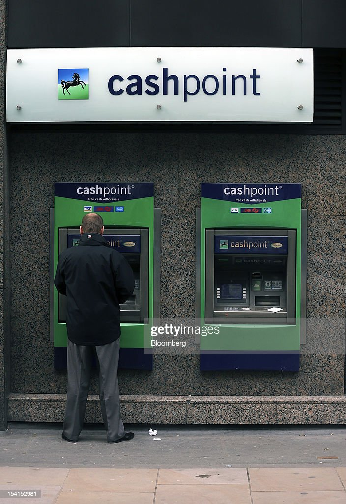 A customer uses an automated teller machine (ATM) outside a Lloyds TSB bank branch, part of the Lloyds Banking Group Plc, in London, U.K., on Monday, Oct. 15, 2012. U.S. homeowners filed a lawsuit against 12 banks, including Lloyds Banking Group Plc, Barclays Bank Plc, and JPMorgan Chase & Co., claiming that manipulation of the benchmark Libor lending rate made their mortgage repayments more expensive. Photographer: Simon Dawson/Bloomberg via Getty Images