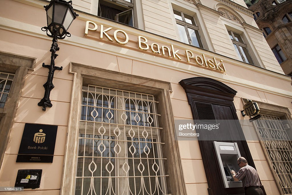 A customer uses an automated teller machine (ATM) outside a PKO Bank Polski SA bank branch in Wroclaw, Poland, on Friday, June 14, 2013. PKO Bank Polski SA, Poland's biggest lender, surged to a five-month high after signing an agreement to buy Nordea Bank AB's Polish assets to increase its dominance on the European Union's largest eastern market. Photographer: Bartek Sadowski/Bloomberg via Getty Images