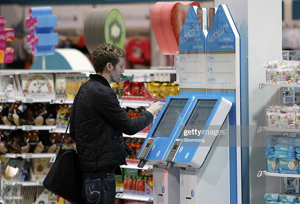 A customer uses an electronic screen at a browse and order point in a Kiddicare Ltd. store, operated by WM Morrison Supermarkets Plc, in Nottingham, U.K., on Wednesday, Sept. 26, 2012. An index of U.K. retail sales rose for the first time in three months in September and stores expect demand to increase further next month, the Confederation of British Industry said. Photographer: Paul Thomas/Bloomberg via Getty Images