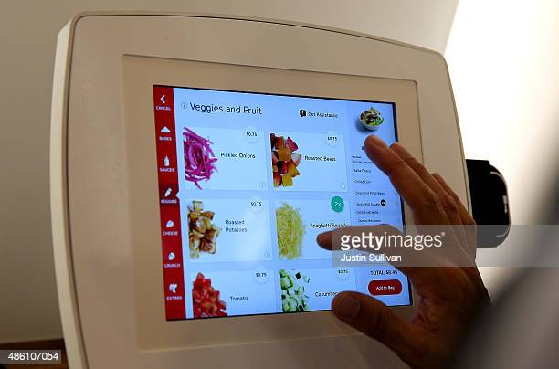 A customer uses an interactive kiosk to place orders at eatsa a fully automated fast food restaurant on August 31 2015 in San Francisco California...