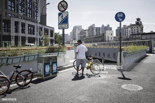 A customer using an Ofo Inc bicycle stops at a flight of steps in Shanghai China on Thursday Sept 12 2017 Across Chinese cities sidewalks are filling...