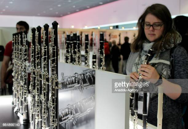 A customer views a flute during the International Trade Fair for musical instruments sheet music music production and marketing 'Musikmesse'...
