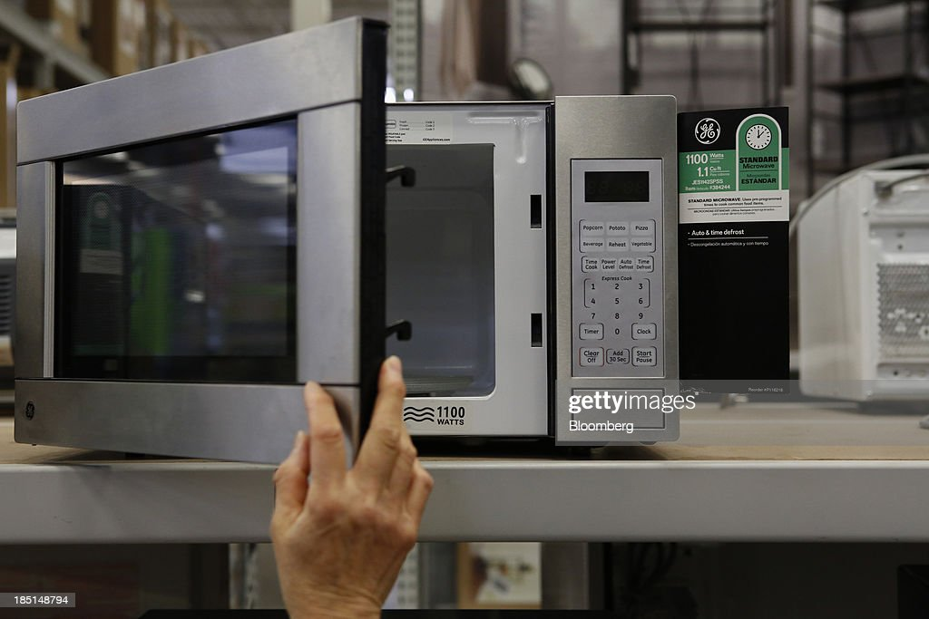 a customer views a general electric co ge microwave oven displayed for sale