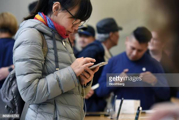 A customer views an Apple Inc iPhone X smartphone during the sales launch at a store in San Francisco California US on Friday Nov 3 2017 The $1000...