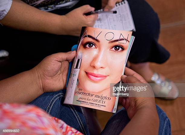 A customer views an Avon Products Inc product catalog in McAllen Texas US on Thursday Aug 28 2014 The top 10 US Avon districts are mostly Hispanic...