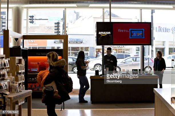 A customer views merchandise in front of an Amazoncom Inc PopUp store inside the Lakeview Whole Foods Market Inc store in Chicago Illinois US on...