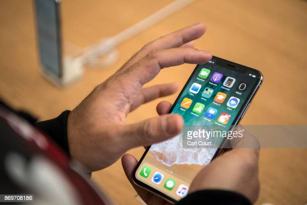 A customer views the iPhone X upon its release in the UK on November 3 2017 in London England The iPhone X is positioned as a highend model intended...