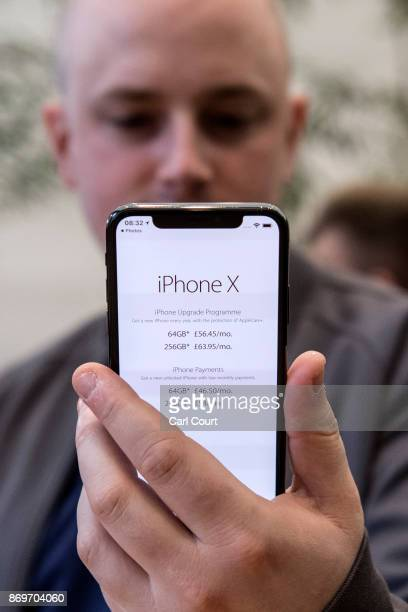 A customer views the new iPhone X upon its UK release in the Apple store on November 3 2017 in London England The iPhone X is positioned as a highend...