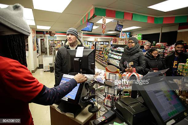 A customer wait in line to purchase Powerball tickets at a 7Eleven store January 9 2016 in Chicago Illinois The Powerball Jackpot Surged to a record...
