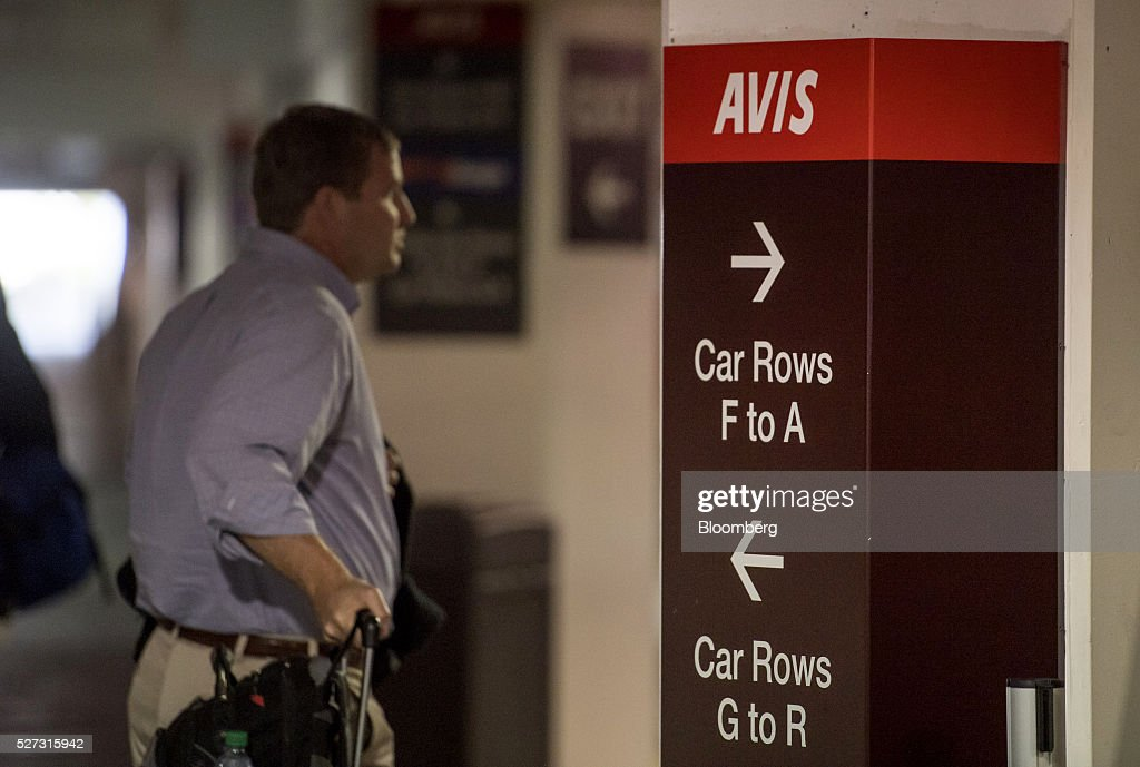 A customer waits for a car to be delivered at the Avis Budget Group Inc. garage at San Francisco International Airport (SFO) in San Francisco, California, U.S., on Monday, May 2, 2016. Avis Budget Group Inc. is expected to release earnings figures on May 3. Photographer: David Paul Morris/Bloomberg via Getty Images