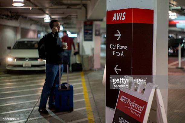 A customer waits for his car to be delivered in the garage of the Avis Budget Group Inc at the San Francisco International Airport in San Francisco...