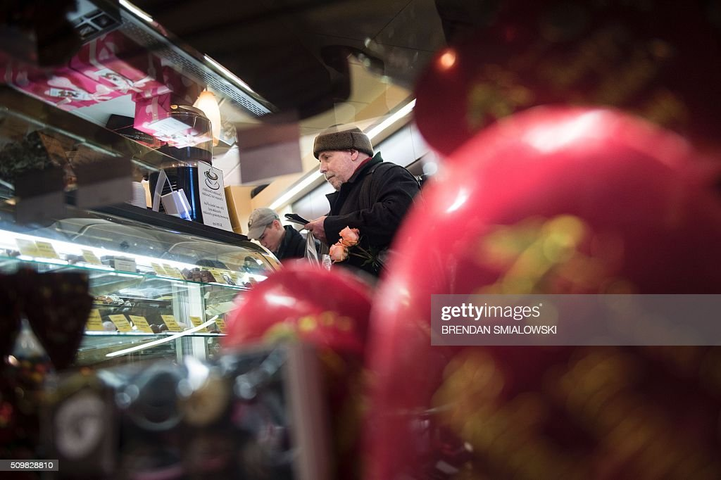 A customer waits to pay for Valentine's Day candy at the Chocolate Moose on February 12, 2016 in Washington, DC. Valentine's Day is observed on February 14. / AFP / Brendan Smialowski