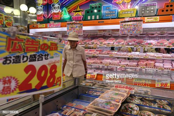 A customer walk through a Super Tamade KK supermarket in the Tenjinbashi district of Osaka Japan on Monday Oct 9 2017 Amid the gloom and struggle...