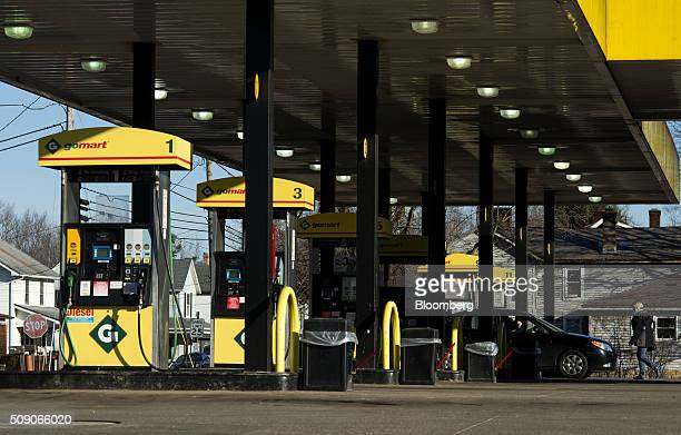 A customer walks back to a vehicle after paying for fuel at a Go Mart Inc gas station in Rockbridge Ohio US on Saturday Feb 6 2016 Thanks to a glut...