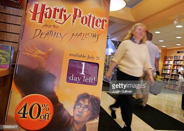A customer walks by a sign advertising the new Harry Potter book at a Borders store on July 19 2007 in San Francisco California Bookstores and...