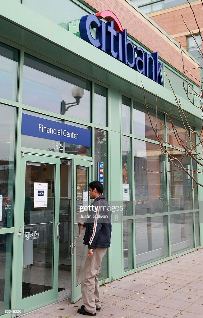 A customer walks into a Citibank branch office November 11, 2008 in Des Plaines, Illinois. Citigroup announced Monday that they will be stopping foreclosures for borrowers who live in their own homes and who make enough money to pay reduced mortgage payments. The bank also is making plans to reach out to nearly 500,000 homeowners who are at risk of falling behind on their mortgage payments