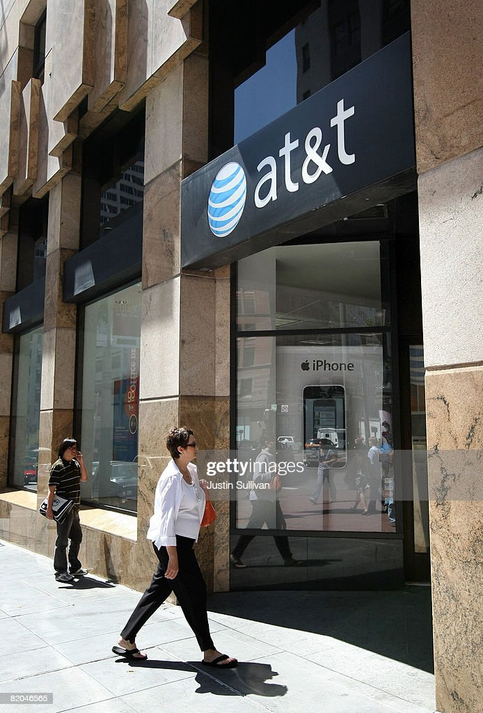 A customer walks into an AT&T Wireless store July 23, 2008 in San Francisco, California. AT&T reported a 30 percent increase in second quarter earnings today citing storing sales of the Apple iPhone. The company earned $3.77 billion, or 63 cents per share compared to $2.90 billion, or 47 cents per share, one year ago.