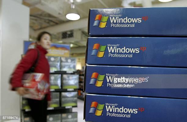 A customer walks near a display of Microsoft Windows XP software at a CompUSA store March 22 2006 in San Francisco California Microsoft the world's...