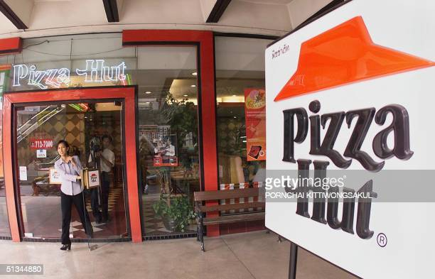A customer walks out of a Pizza Hut restaurant 20 January 2000 at a Bangkok branch of the US food franchise Thailand's Pizza Plc said it would give...