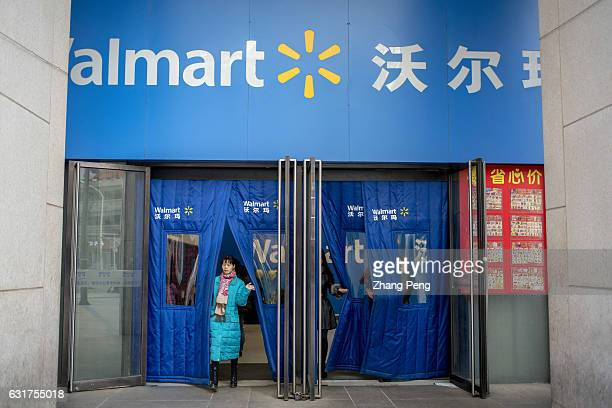 A customer walks out of a Walmart store Walmart is about to start a major test of blockchain technology for supply chain management which is supposed...