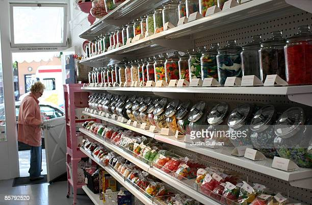 A customer walks out of Sweet Dish candy store April 3 2009 in San Francisco California As the economy continues to struggle candy sales are rising...
