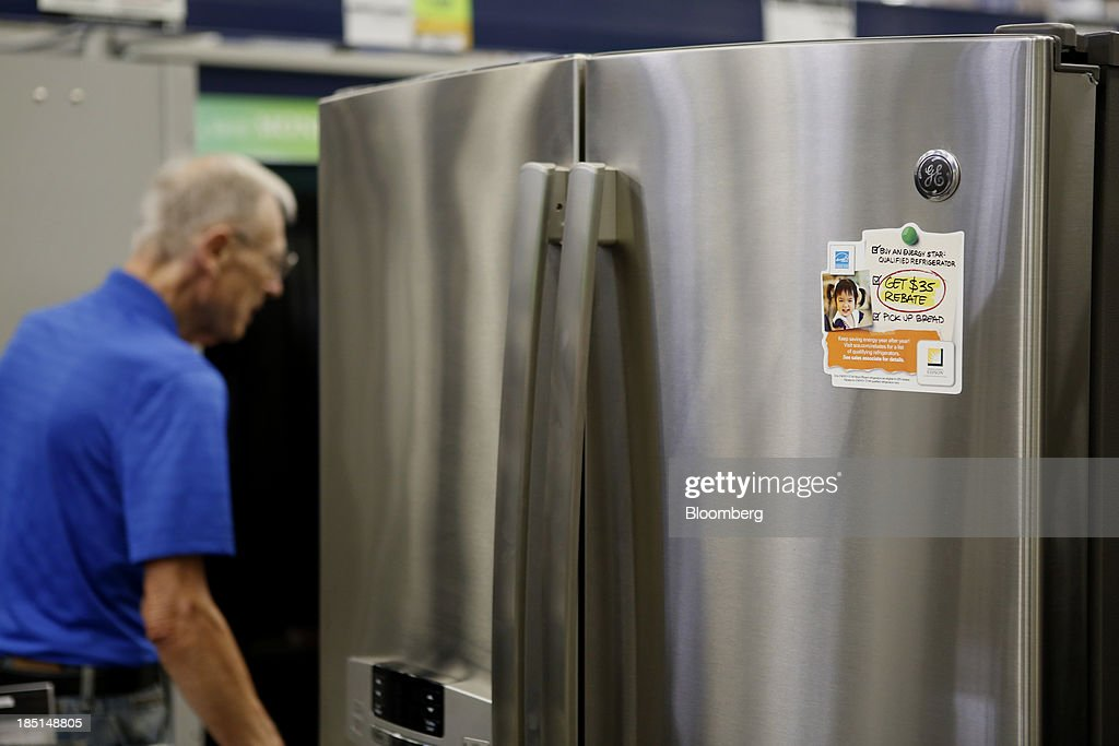 A customer walks past a General Electric Co. (GE) refrigerator for sale at a Lowe's Cos. store in Torrance, California, U.S, on Thursday, Oct. 17, 2013. General Electric Co. is scheduled to release earnings figures on Oct. 18. Photographer: Patrick T. Fallon/Bloomberg via Getty Images