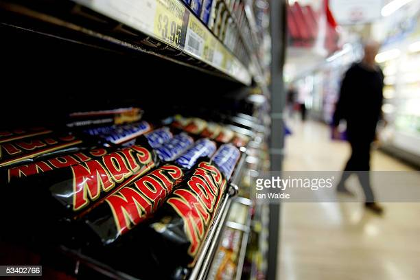 A customer walks past a Mars and Snickers Bar display in a supermarket August 18 2005 in Sydney Australia Mars and Snickers bars returned to NSW...